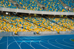 Empty colorful stadium seats and running tracks. Stock Image