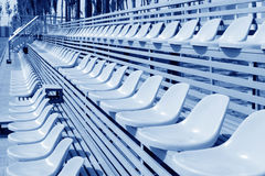 Empty colorful stadium seats Royalty Free Stock Photography