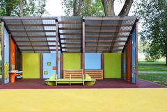 Empty colorful stage. For children performance with copy space for text on yellow rubber flooring in city park in summer day royalty free stock images