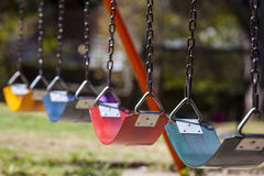 Empty colorful swings Royalty Free Stock Photography