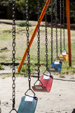 Empty colorful swings Royalty Free Stock Photos