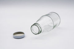 Empty colorless glass bottle Royalty Free Stock Photos