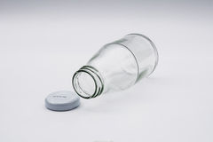 Empty colorless glass bottle Stock Photos