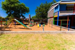 Empty Colourful Preschool Playground slide. Newcastle, South Africa - February 12 2015: Empty Colorful Preschool Playground royalty free stock photos