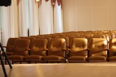 Empty comfortable brown seats in a hall . stock photos