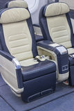 Empty comfortable business class airline seats. Airplane interior Royalty Free Stock Photos