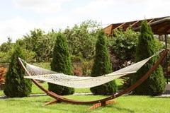 Empty comfortable hammock outdoors Royalty Free Stock Photos