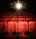 Empty comfortable red seats in cinema. Empty comfortable red seats with numbers in cinema Royalty Free Stock Photos