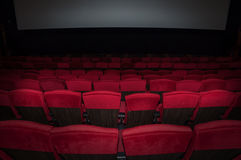 Empty comfortable red seats in thearter back side to screen Stock Photography