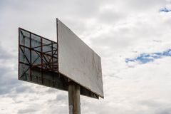 Empty commercial billboard, storm clouds on the background Stock Illustration