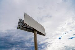 Empty commercial billboard, storm clouds on the background Royalty Free Stock Images