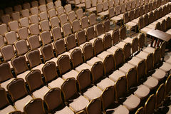 Empty concert hall. Rows of brown seats in empty concert hall Stock Photo