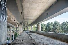 Empty concrete bridge construction. Abandoned empty concrete bridge industrial scene background stock photos