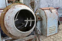 An empty concrete mixer stands on the construction site.  stock image