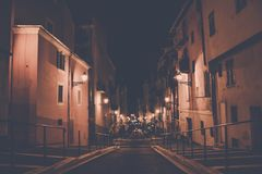 Empty Concrete Road in the Middle of Concrete Buildings at Night Royalty Free Stock Image