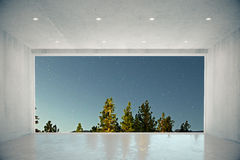Empty concrete room with big window with blue sky and forest vie Stock Photo