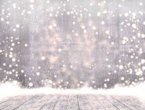 Empty concrete when snowing and ice wood table with snow  Ready for product display montage. Royalty Free Stock Image