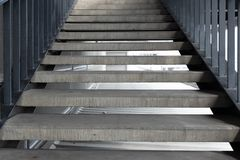 Empty concrete staircase with black steel handrail. Empty concrete staircase with black iron handrail stock photo