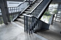Empty concrete staircase with black steel handrail. Empty concrete staircase with black iron handrail royalty free stock photography