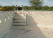 An empty concrete swimming pool. With steps Stock Photo