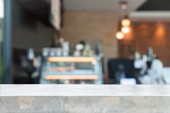 Empty concrete table top with blurred coffee shop Stock Photography