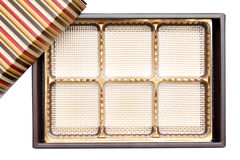 Empty confectionery box. Empty box from sweets of gold color on white background Stock Photo