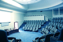 Empty conference hall. In a blue light Stock Image