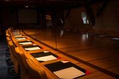 Free Empty Conference Hall At Night Ready For Session Royalty Free Stock Images - 124409549