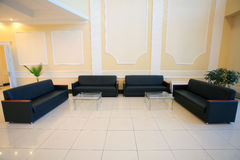Empty conference hall with couches. Wide angle shot of empty conference hall with couches Royalty Free Stock Photo