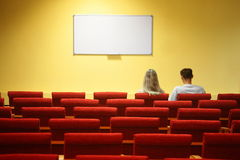Empty conference hall. couple sitting in chairs Royalty Free Stock Photos