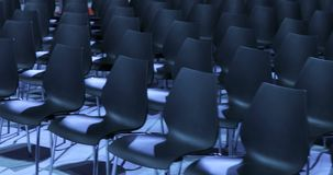 View of empty Conference hall with comfortable seats. conference room for the business audience. Free empty chairs or