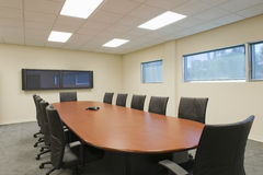 Empty Conference Room. Empty chairs around table in a conference room Royalty Free Stock Photography
