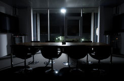 Empty conference room at night. An empty conference room bathed in moonlight Royalty Free Stock Images