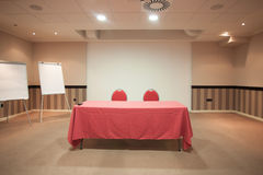 Empty conference room with red table Stock Images