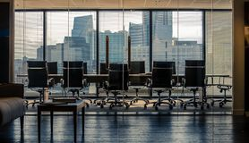 Free Empty Conference Room Workspace Showing Cityscape Skyline Royalty Free Stock Photos - 164862108