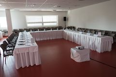 Empty congress room before seminar, bottles of mineral water on table stock photos