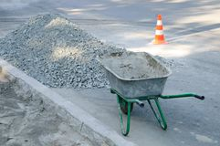 An empty construction cart on the sidewalk. royalty free stock photography