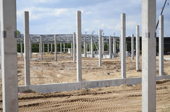 Empty construction site. Concrete poles at the construction site of industrial building Royalty Free Stock Image