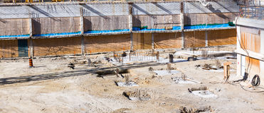 Empty construction site for new shopping mall. Stock Photos