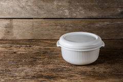 Empty containers for food on wooden background Stock Images