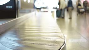 Empty conveyor belt in an airport. Close up of an empty conveyor belt in an airport in Germany. Concept of travelling and tourism. Locked down real time close up stock footage