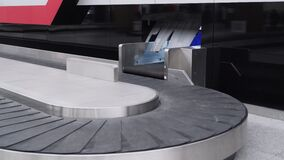 Empty conveyor belt in the baggage claim area of international airport