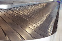 Empty conveyor belt in baggage claim area at modern airport royalty free stock photo