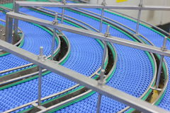 Empty conveyor belt. Empty blue conveyor belt  - close up Stock Image