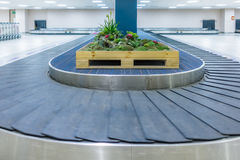 Empty conveyor belt for carrying the passenger luggage or baggag Royalty Free Stock Images