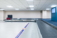 Empty conveyor belt for carrying the passenger luggage or baggag Royalty Free Stock Photography