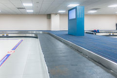 Empty conveyor belt for carrying the passenger luggage or baggag Stock Images
