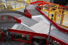 Conveyor sorting belt at distribution warehouse. Empty conveyor sorting belt at distribution warehouse. Distribution hub for sorting packages and parcels stock image