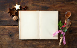 Empty cookbook for Christmas recipes. On wooden table Royalty Free Stock Photography