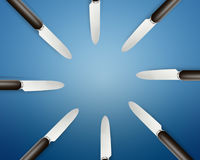 Empty copy space circle in set of knives. On blue Background Royalty Free Stock Photos